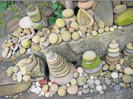 石头,恐有邪灵附身其中。