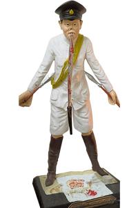 阿赞丰圣像,一支长长的尖刀垂直插在口中的造型。