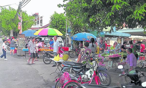 务边县拉湾古打村,华族人口密集,当中以客家人占多数。