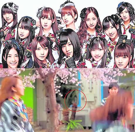 """窗边的""""女子""""出现在《10年樱》MV里看着AKB48的美眉热舞。"""