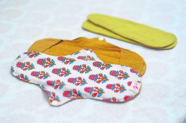 选购布卫生棉的要点是布料舒适(纯棉),同时单层不能太厚,以避免清洗不彻底。所以市面上有些产品以加插垫子或折叠的方式来增加厚度。