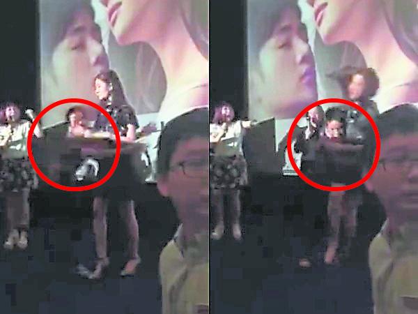 圈中男子突然冲上台抱着刘亦菲撞倒在地。