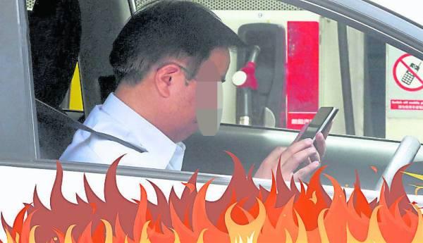 在添油站内绝对不能使用手机,这是最基本的安全意识。