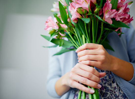 Close-up of bunch of fragile lilies in female hands