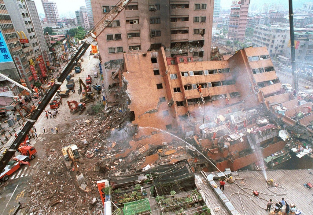 A hotel complex lies crumbled and destroyed in Taipei, Taiwan, following a 7.6 magnitude earthquake which struck early Tuesday, Sept. 21, 1999.  Cost cutting by contractors is being blamed by many officials for the collasped of many newer building.  (AP Photo/Wally Santana)