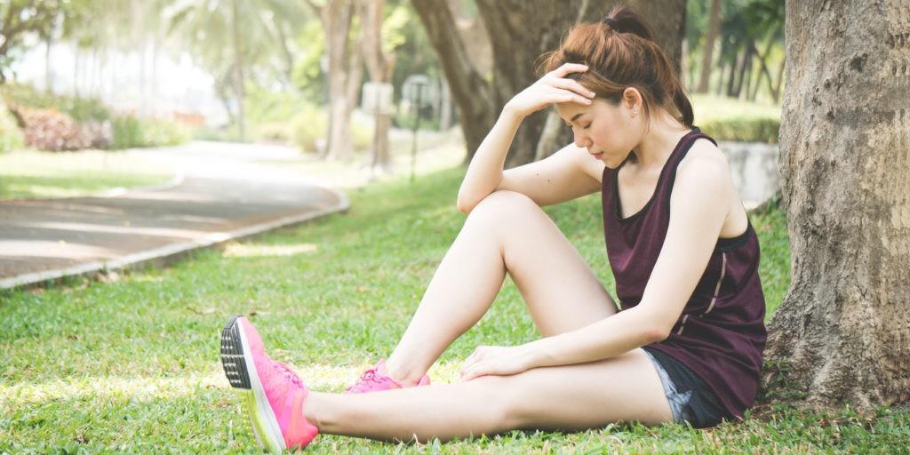 Asian sport woman faint after running in park outdoor